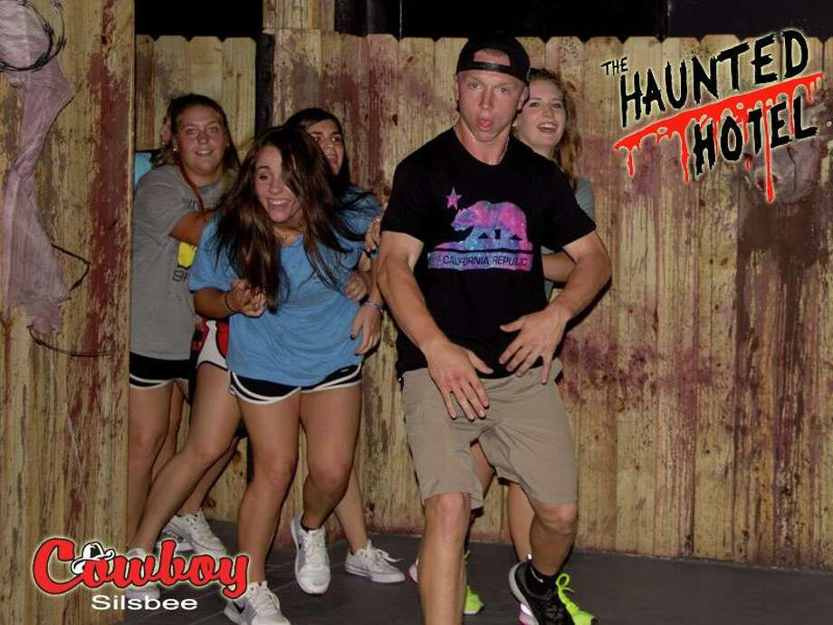 Patrons — some terrified, and some amused — exit Beaumont's Haunted Hotel. Photo: The Haunted Hotel - Texas/Facebook