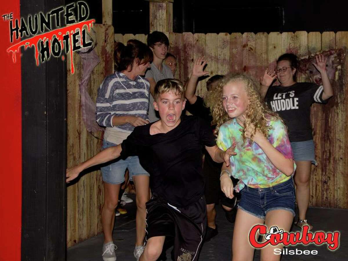 Patrons - some terrified, and some amused - exit Beaumont's Haunted Hotel.