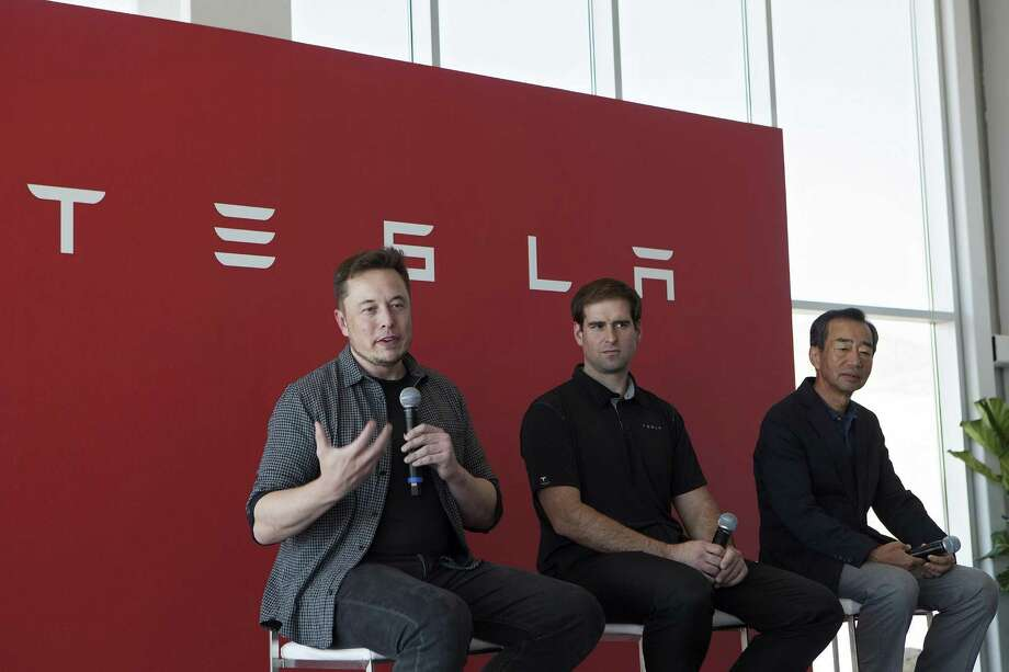 Tesla CEO Elon Musk (left),  speaks as Jeffrey Straubel (center), chief technical officer and co-founder of Tesla, and Yoshihiko Yamada, consultant at Panasonic Corp., look on during a July news conference on the opening of Tesla's Gigafactory. Tesla and Panasonic are extending their partnership, which includes the production of electric vehicle and grid storage battery cells at the Gigafactory. Tesla said the companies have signed a nonbinding letter of intent to begin collaborating on Panasonic's production of photovoltaic cells and modules at a facility under construction by solar-panel company SolarCity Corp. Photo: Troy Harvey /Bloomberg News / © 2016 Bloomberg Finance LP