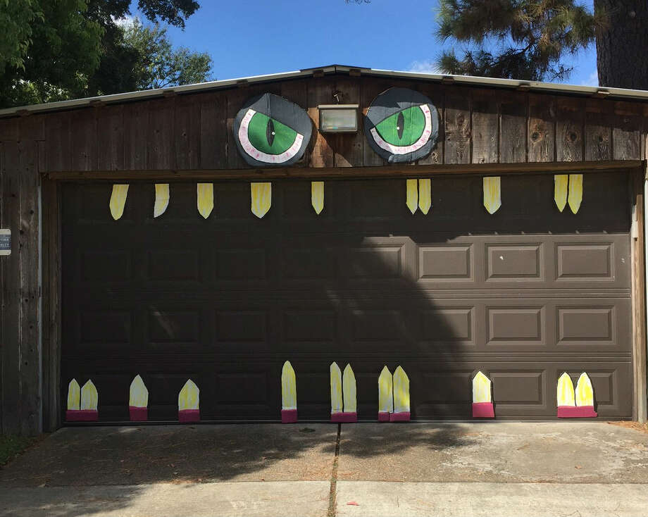 A Houston Heights resident decided to get into the Halloween season spirit by turning her garage into a terrifying monster with huge cardboard teeth, a move that will surely scar the brains of area children. Photo: Jessica Hamilton
