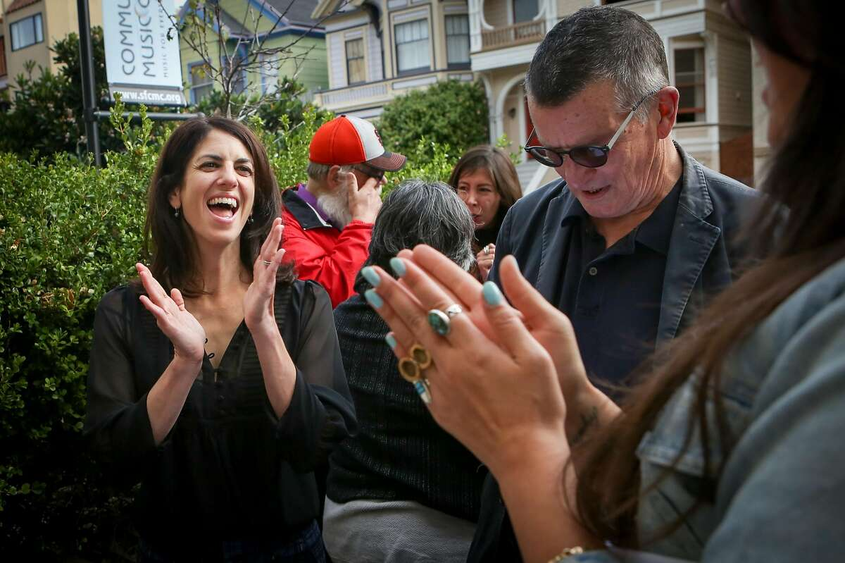 Hillary Ronen (left) applauds Buck Bagot (center) and Erin Mundy (right), after practicing how to canvas at the San Francisco Tenants Union before they leave to knock on doors in the Mission neighborhood on Saturday, Oct. 15, 2016 in San Francisco, Calif.
