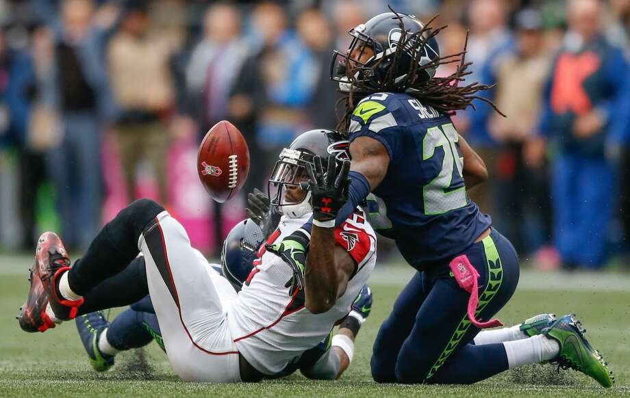 Wide receiver Julio Jones #11 of the Atlanta Falcons can't make the catch on fourth down as cornerback Richard Sherman #25 of the Seattle Seahawks defends at CenturyLink Field on October 16, 2016 in Seattle, Washington.  (Photo by Otto Greule Jr/Getty Images) Photo: Otto Greule Jr/Getty Images