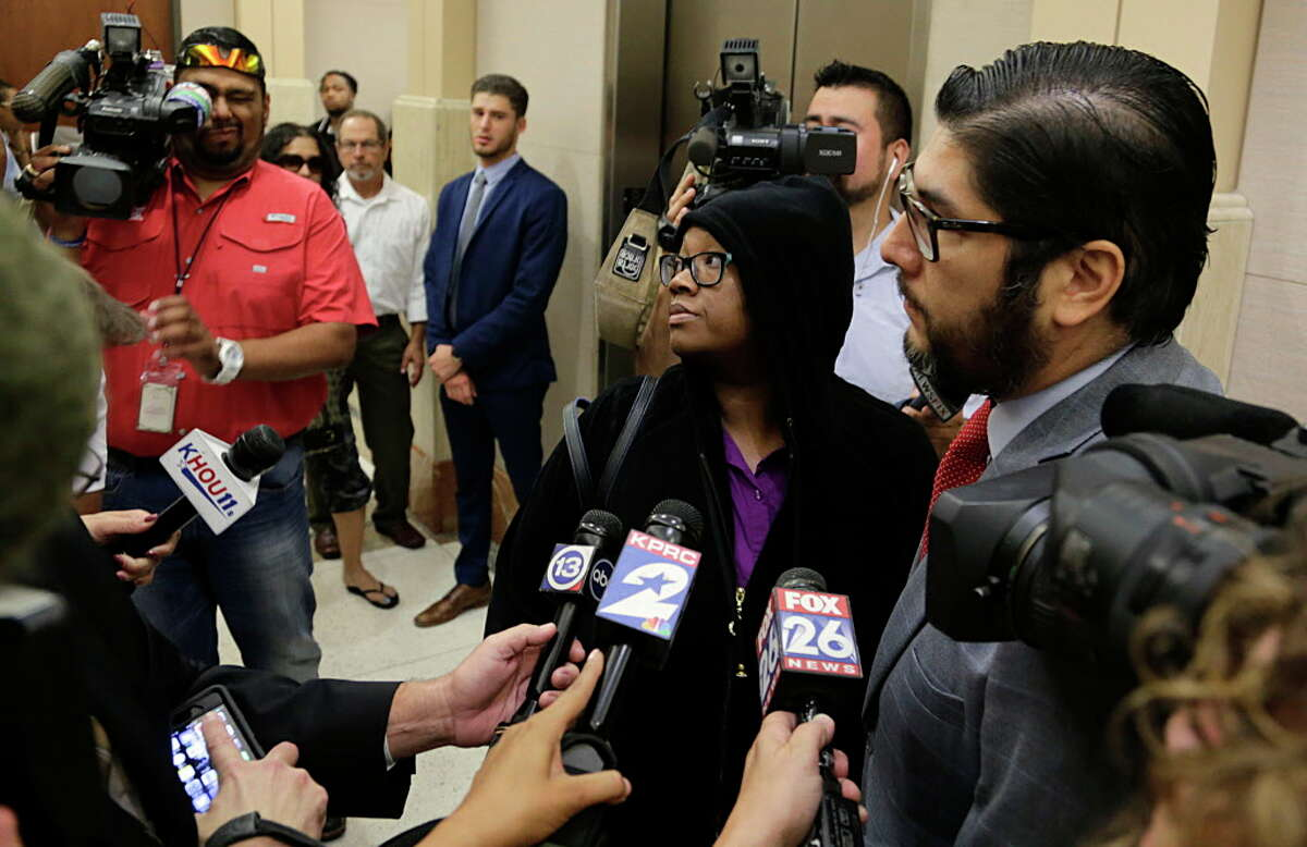 Crenshanda Williams center after her appearance before Judge John Clinton in County Criminal Court at Law #4 on two misdemeanor charges for interference with emergency telephone calls Oct. 17, 2016, in Houston.