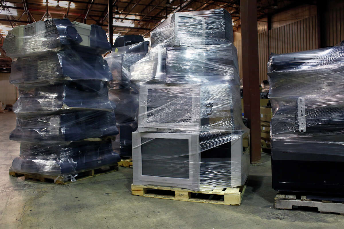 Dozens of used Cathode Ray Tube televisions and computer monitors are stored inside Tech Valley Recycling Thursday, Aug. 7, 2014, in Clifton Park, N.Y. (Tom Brenner/ Special to the Times Union)