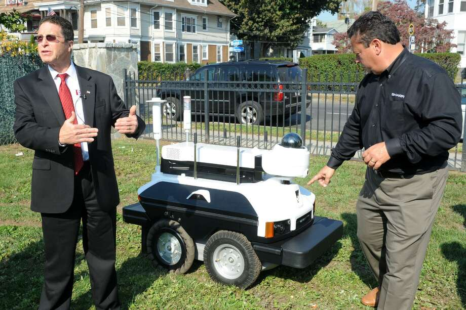 David Antar, President of A+ Technology & Security Solutions, left, and David Lewis of Sharp Robotics Business Development answer questions at the unveiling of the Sharp INTELLOS, an Automated Unmanned Ground Vehicle in Bridgeport, Conn. Oct. 17, 2016. Photo: Ned Gerard / Hearst Connecticut Media / Connecticut Post