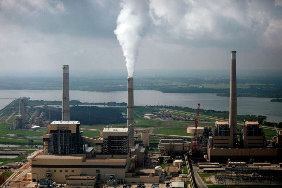 CPS Energy's coal-fired power plants J.K. Spruce (left) and Deely (right stack) on Calaveras Lake. The utility said all of its thermal plants were running due to the severe cold weather. Photo: San Antonio Express-News File Photo / SAN ANTONIO EXPRESS-NEWS