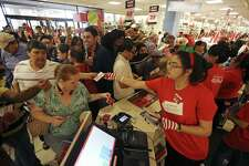 Shoppers grab for coupons as they enter the JCPenney at North Star Mall on Gray Thursday 2015. The company plans to hire 600 employees in the San Antonio area for the 2016 holiday shopping season.