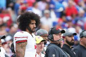 BUFFALO, NY - OCTOBER 16:   Colin Kaepernick #7 of the San Francisco 49ers and head coach Chip Kelly of the San Francisco 49ers look on from the sideline during the first half against the Buffalo Bills at New Era Field on October 16, 2016 in Buffalo, New York.  (Photo by Tom Szczerbowski/Getty Images)