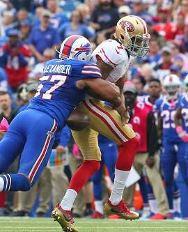 San Francisco 49ers quarterback Colin Kaepernick (7) losses the ball after being hit by Buffalo Bills linebacker Lorenzo Alexander (57) during the second half of an NFL football game on Sunday, Oct. 16, 2016, in Orchard Park, N.Y. (AP Photo/Bill Wippert)