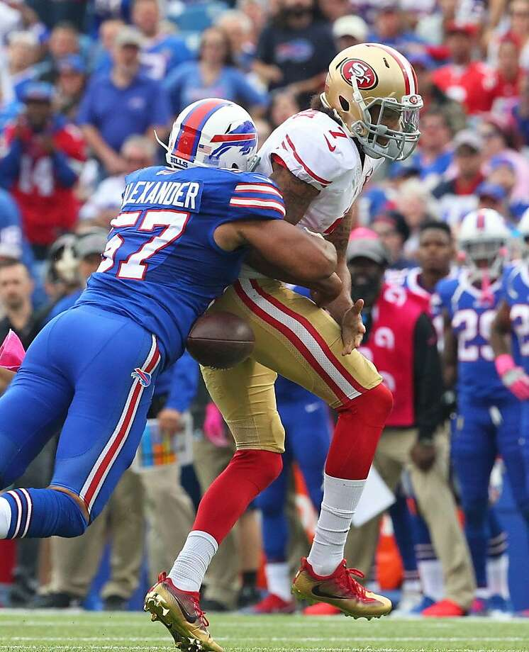 San Francisco 49ers quarterback Colin Kaepernick (7) losses the ball after being hit by Buffalo Bills linebacker Lorenzo Alexander (57) during the second half of an NFL football game on Sunday, Oct. 16, 2016, in Orchard Park, N.Y. (AP Photo/Bill Wippert) Photo: Bill Wippert, Associated Press