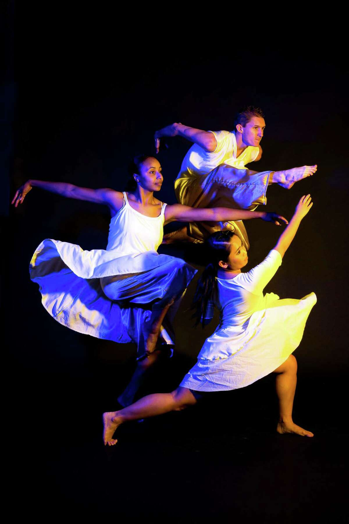 """Brittany Bass, from left, Brian Peck and Jerrica Mark are among the performers in Karen Stokes Dance's """"Deep Seaspace"""" Oct. 20-22 at Hobby Center."""
