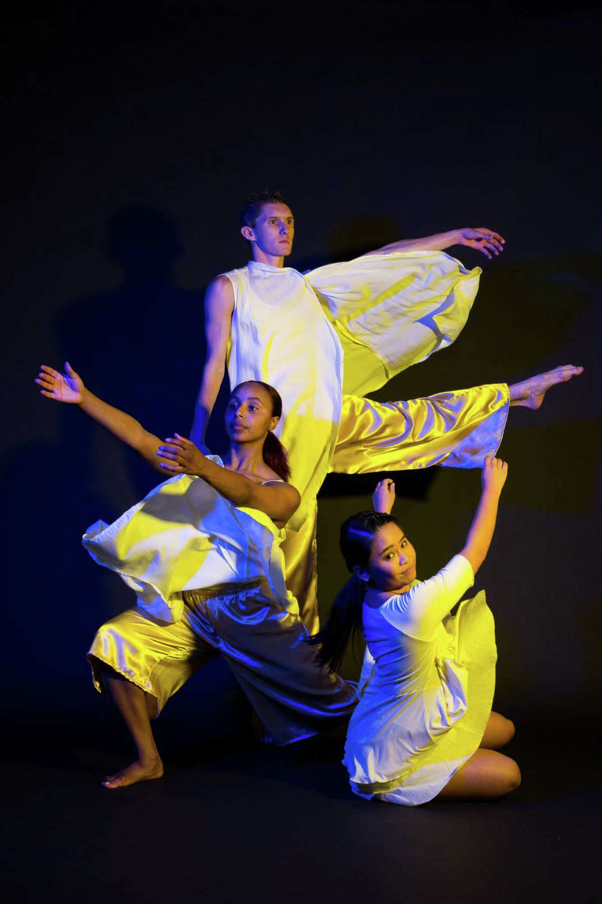 """Brittany Bass, from left, Brian Peck and Jerrica Mark will be among the performers taking part in Karen Stokes Dance's """"Deep: Seaspace"""" at the Hobby Center."""