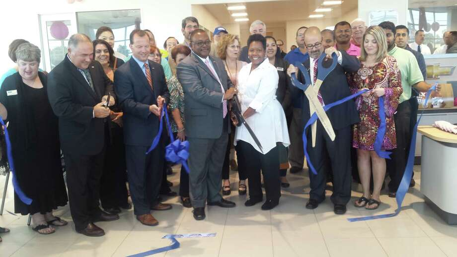 Robert Turner along with David Mendez and Turner Chevy staff celebrate the ribbon cutting Thursday, Oct. 13. Photo: Jennifer Summer