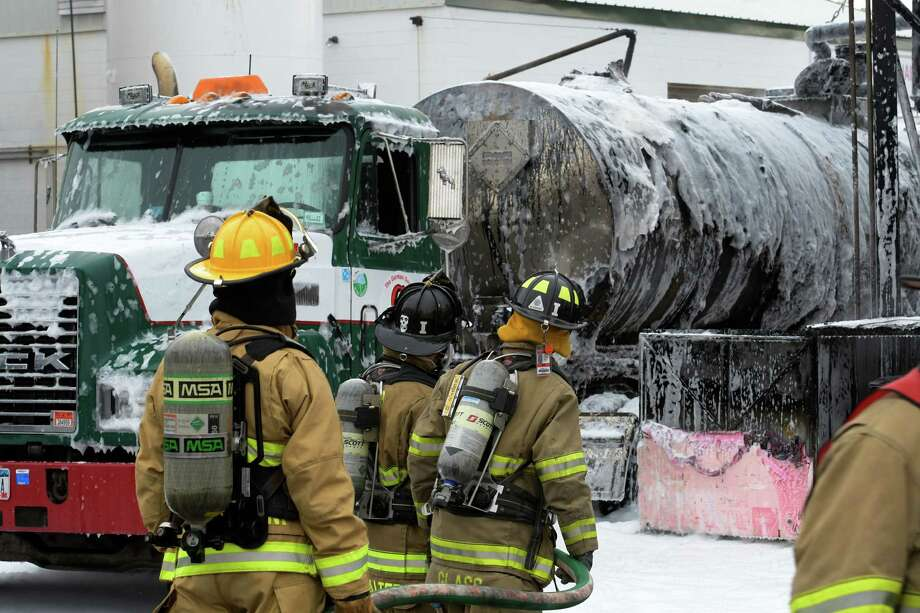 Fire personnel cool hotspots at the scene of a tanker truck explosion at Gorman's Mohawk Asphalt Emulsions  Monday Oct. 17, 2016 in Glenville ,  N.Y.   (Skip Dickstein/Times Union) Photo: SKIP DICKSTEIN