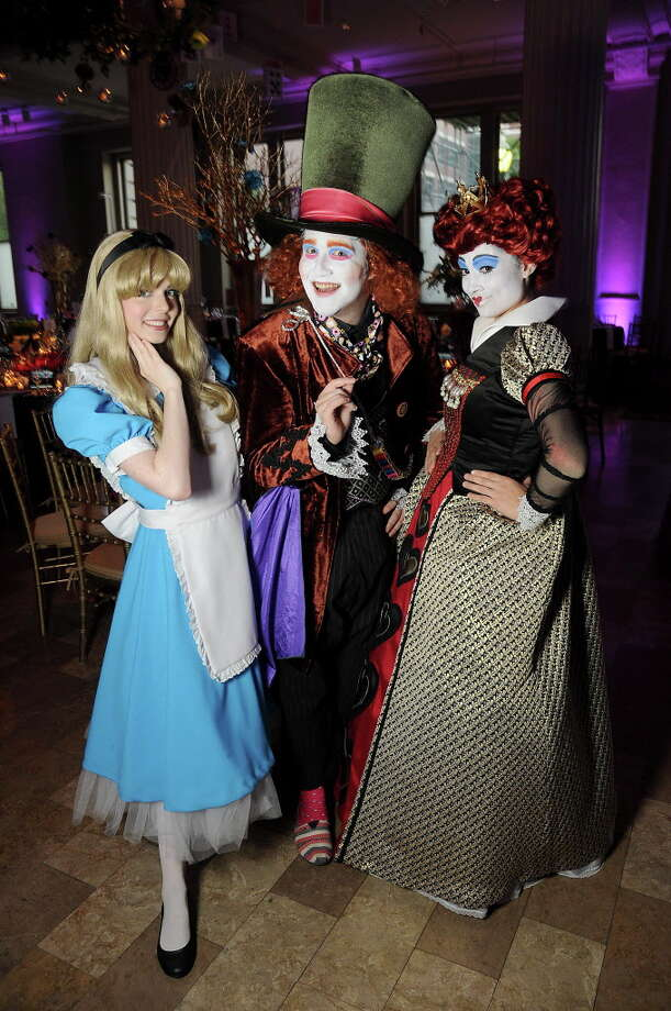"From left: Savannah Ezelle as Alice, Tyler Galindo as the Mad Hatter and Crystal Sharadin as the Queen of Hearts at the Children Museum of Houston's ""Mad Hatter's Ball"" at The Corinthian Saturday Oct. 15,2016.(Dave Rossman photo) Photo: Dave Rossman, For The Chronicle / Dave Rossman"
