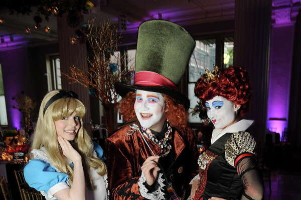 "From left: Savannah Ezelle as Alice, Tyler Galindo as the Mad Hatter and Crystal Sharadin as the Queen of Hearts at the Children Museum of Houston's ""Mad Hatter's Ball"" at The Corinthian Saturday Oct. 15,2016.(Dave Rossman photo)"