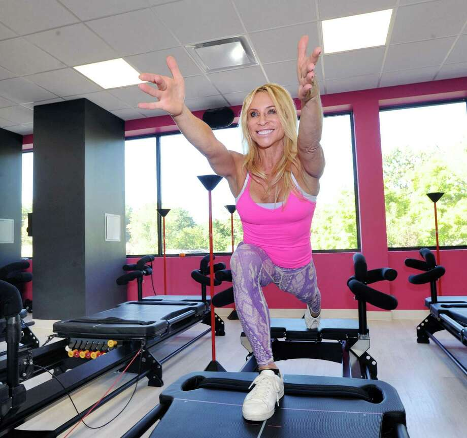 Cat Wagner, owner of Catwalk Fitness, demonstrates the M3 Megaformer exercise machine at her business in Old Greenwich, Conn., Friday, Oct. 14, 2016. Photo: Bob Luckey Jr. / Hearst Connecticut Media / Greenwich Time