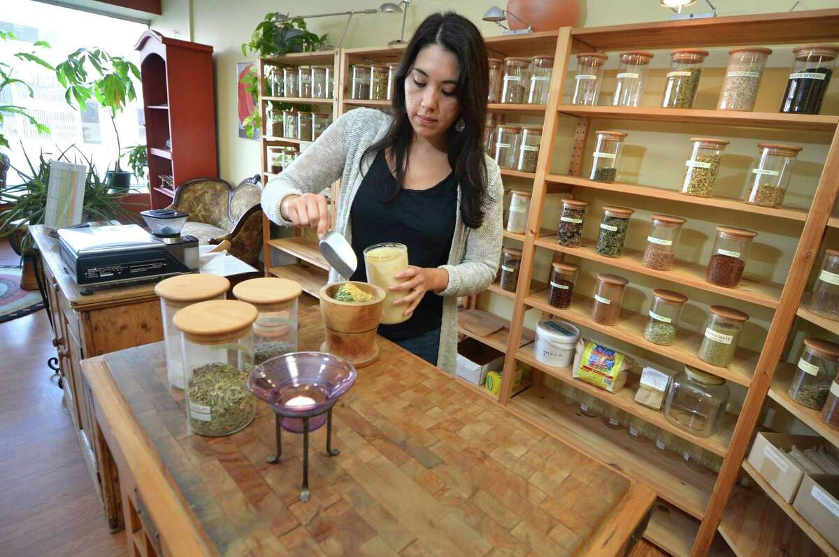 Anna Perelli, Manager at the Centre for Natural Healing mixes herbs such as chamomile, and lavender with others for a special stress buster herb tea at the Herbal and Nutritional Apothecary and Retail Store on Wall St. in Norwalk Conn, on Monday October 17, 2016