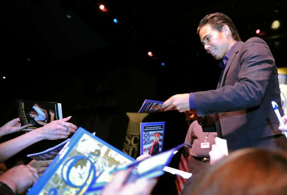 Eight-time Olympic medalist Apolo Ohno signs autographs following his talk during the 12th Mary and Louis Fusco Distinguished Lecture Series  Wednesday May 12, 2010 at Southern Connecticut State University's John Lyman Center for the Performing Arts. Photo: Autumn Driscoll / Connecticut Post