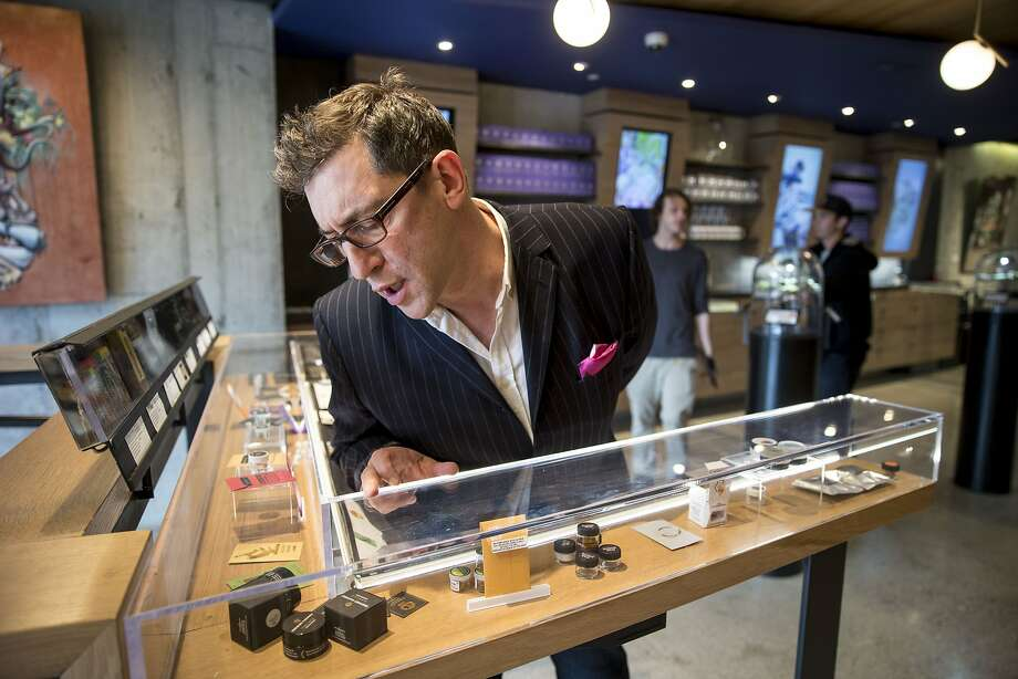 "Joe Dolce checks out the products at Medithrive, a medical marijuana dispensary in San Francisco's Mission District on Oct. 15. Dolce is the author of ""Brave New Weed."" Photo: Santiago Mejia, The Chronicle"