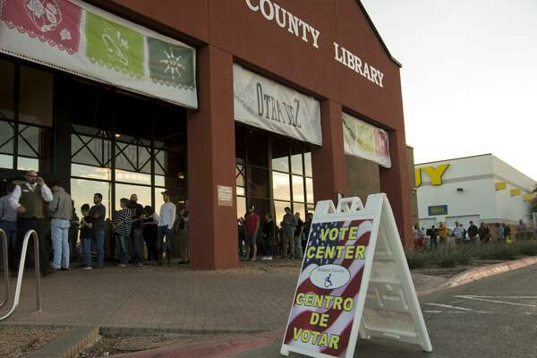 Voters wait in line outside the Centennial Library Tuesday 03-01-16 evening to cast their ballot. Tim Fischer\Reporter-Telegram