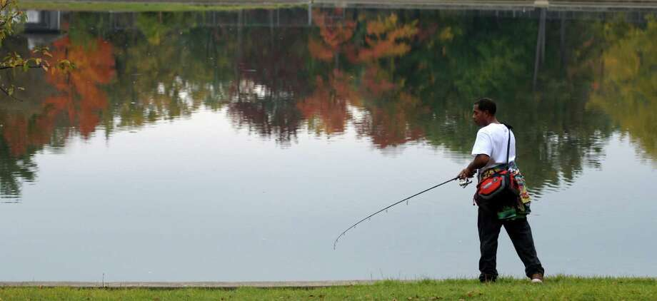 Sam Powell tries his hand at some fishing in Central Park lake Monday Oct. 17, 2016 Schenectady ,  N.Y.   (Skip Dickstein/Times Union) Photo: SKIP DICKSTEIN