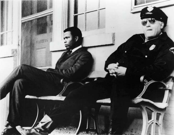 """Actors Sidney Poitier and Rod Steiger appear in a scene from the 1967 movie """"In the Heat of the Night."""""""