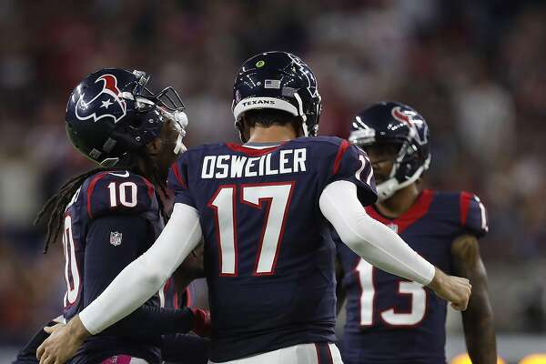 Houston Texans quarterback Brock Osweiler (17) huddles with wide receiver DeAndre Hopkins (10) during the third quarter of an NFL football game at NRG Stadium, Sunday,Oct. 16, 2016 in Houston.   ( Karen Warren / Houston Chronicle )