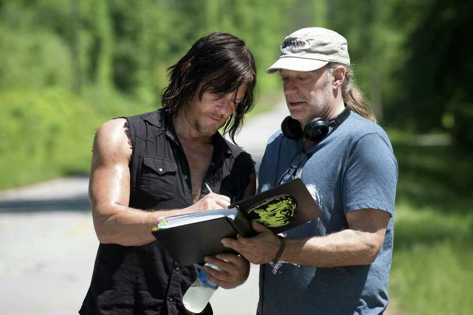"""Norman Reedus as Daryl Dixon and Greg Nicotero work on a scene from season six, episode one of """"The Walking Dead."""" AMC Networks, best known for the U.S. cable channel that airs """"The Walking Dead,"""" is investing $65 million in RLJ Entertainment, a company backed by the founder of Black Entertainment Television. The goal is to create a partnership aimed at reaching two niche audiences — African-American viewers and fans of British programming — with online video services. Photo: AMC / Orange County Register"""