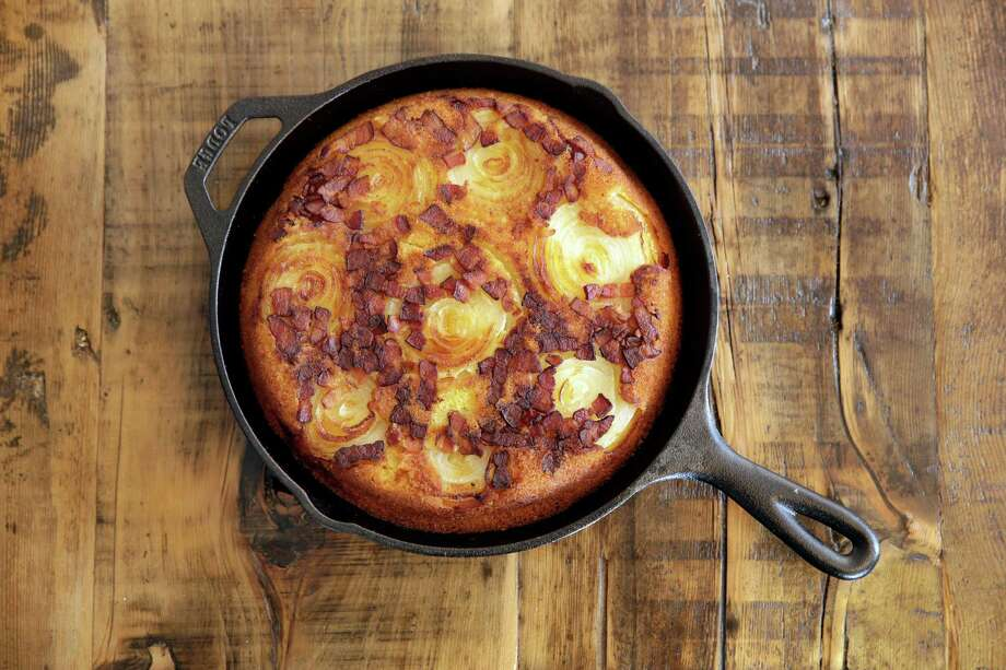 Cooked in a cast-iron skillet, this Vidalia onion cornbread is light and cakey with a little tang and sweetness. The onions taste almost like they've been fried. Photo: Richard Drew, STF / AP