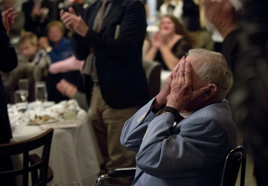 Former baseball coach Tom Deneen is overcome with emotion as he gets a standing ovation after being inducted into the Greenwich High Hall of Fame at the Greenwich Water Club on Saturday, October 15, 2016. Photo: Lindsay Perry / For Hearst Connecticut Media / Greenwich Time Freelance