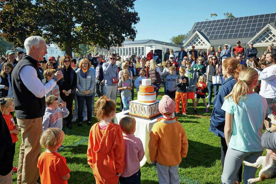 Former Headmaster Doug Lyons (left) along with parents, faculty, staff and students celebrate the 90th birthday of the Greenwich Country Day School on Oct. 15, 2016. Photo: Contributed /