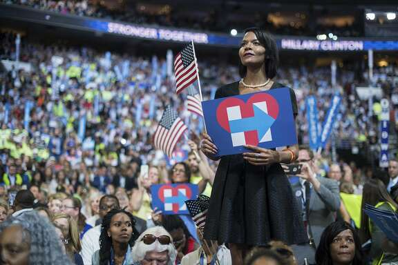 UNITED STATES - JULY 28: Sharron Cooks, a transgender woman delegate from Pennsylvania, looks on as Democratic Presidential nominee Hillary Clinton, speaks at the Wells Fargo Center in Philadelphia, Pa., on the final night of the Democratic National Convention, July 28, 2016. (Photo By Tom Williams/CQ Roll Call)