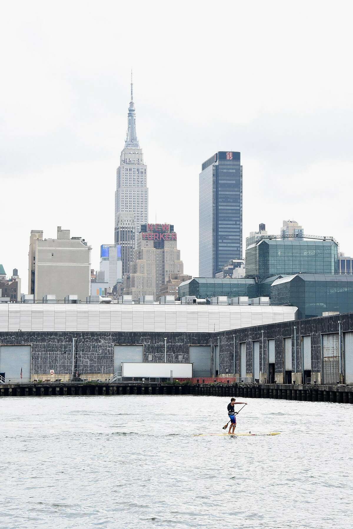 NEW YORK, NY - AUGUST 20: Stand-up paddle surfer Kai Lenny competes in SEA Paddle NYC in which TAG Heuer is the Official Timepiece and Official Timekeeper on August 20, 2016 in New York City. (Photo by Eugene Gologursky/Getty Images for Tag Heuer)