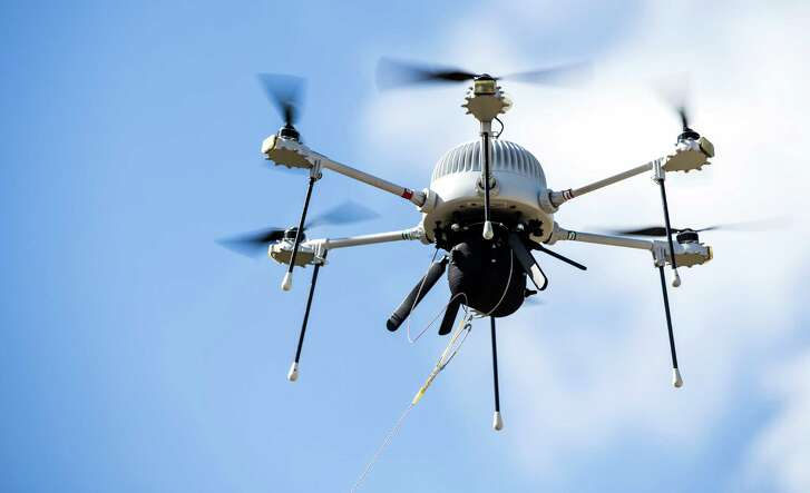 A tethered drone takes flight Monday at the Houston Spaceport. It captured video of vessels and automobiles.