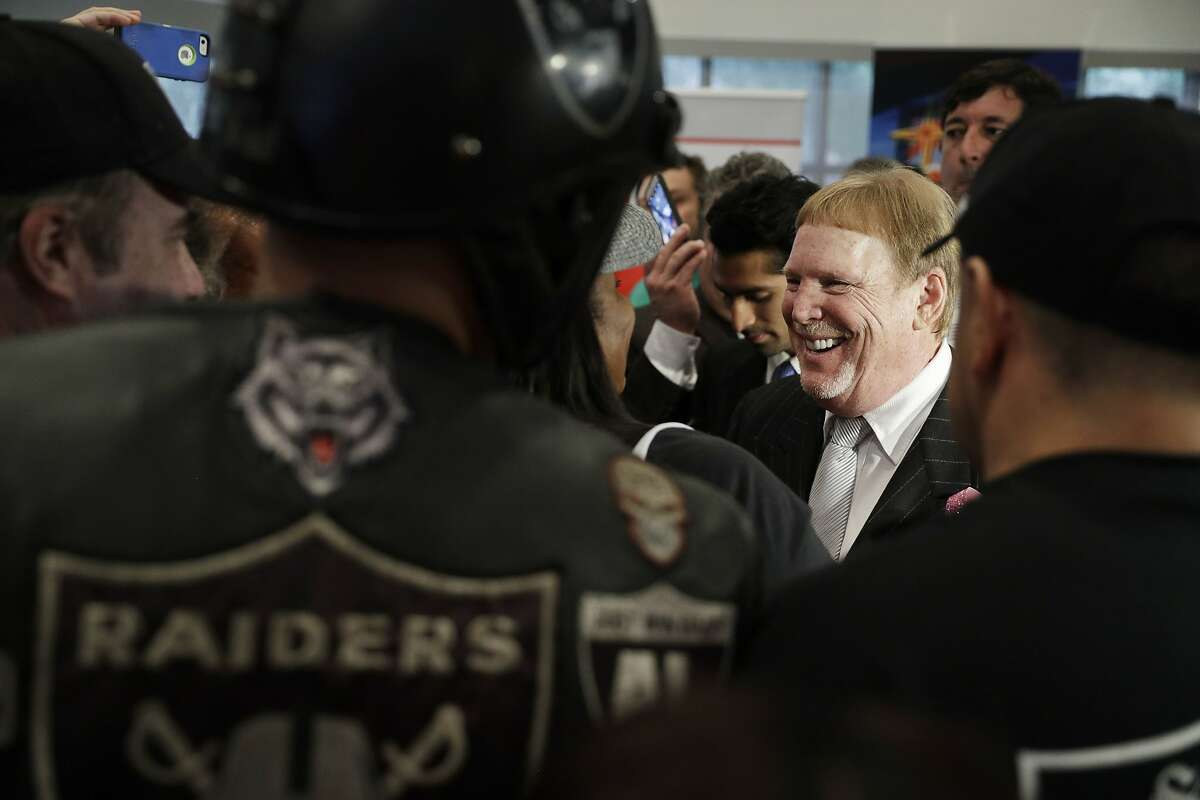 Oakland Raiders owner Mark Davis speaks with fans after a signing ceremony Monday, Oct. 17, 2016, in Las Vegas. Nevada Governor Brian Sandoval signed a bill into law that clears the way for a Las Vegas stadium that could be home to both UNLV football and the Raiders. (AP Photo/John Locher)