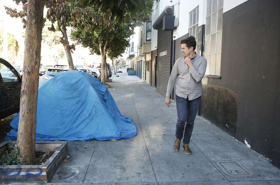 Carl Petersen, architect, walks past a tent along 15th Street, on Wednesday, October 12,  2016 in San Francisco,  California. Photo: Lea Suzuki, The Chronicle