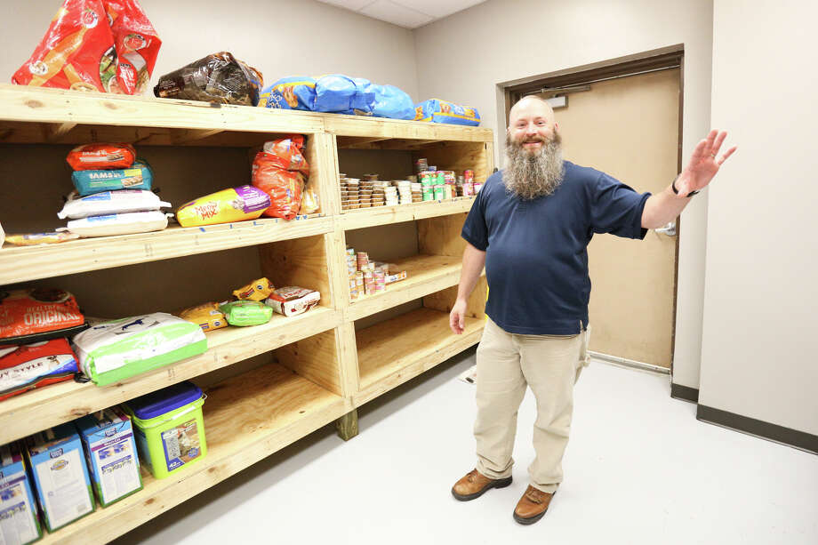 Dr. Todd Hayden, director of the Montgomery County Animal Shelter, describes renovations while standing next to new shelving in the food storage room on Monday, Oct. 17, 2016. Photo: Michael Minasi, Staff / © 2016 Houston Chronicle