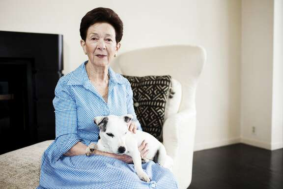 Philanthropist Roselyne Swig and her dog Spud sits for a portrait at her home in San Francisco, Calif. on Wednesday, May 16, 2012.