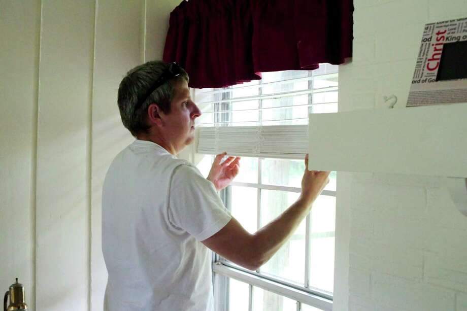 Lowes Contractor Justin Smith installs window blinds during renovations to the Family Promise of Clear Lake Day Center. The Day Center will help homeless families through services and offering daily use of phones and computers to aid with job searches. Family Promise is seeking more church partners to provide sleeping quarters for the families. Photo: Kirk Sides / © 2016 Kirk Sides / Houston Community Newspapers
