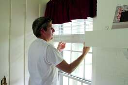 Lowes Contractor Justin Smith installs window blinds during renovations to the Family Promise of Clear Lake Day Center. The Day Center will help homeless families through services and offering daily use of phones and computers to aid with job searches. Family Promise is seeking more church partners to provide sleeping quarters for the families.