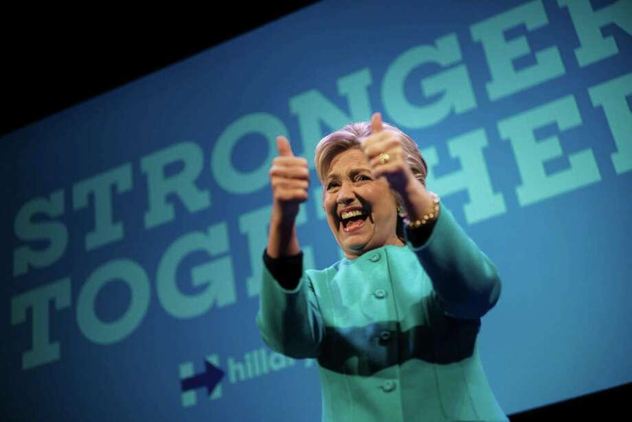 TOPSHOT - Democratic presidential nominee Hillary Clinton cheers after speaking at a fundraiser at the Paramount Theater October 14, 2016 in Seattle, Washington. / AFP PHOTO / Brendan SmialowskiBRENDAN SMIALOWSKI/AFP/Getty Images Photo: BRENDAN SMIALOWSKI, Staff / AFP/Getty Images / AFP or licensors