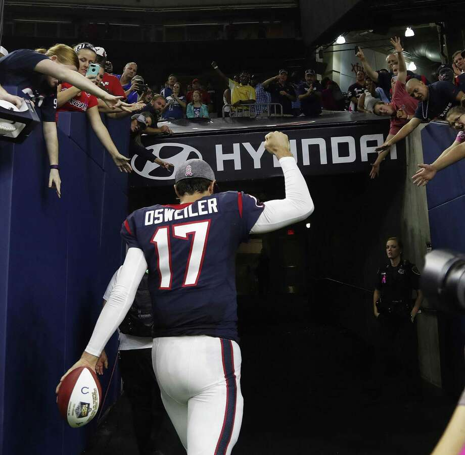 Texans quarterback Brock Osweiler celebrates the overtime win over the Indianapolis Colts with fans after at NRG Stadium on Oct. 16, 2016 in Houston. Photo: Karen Warren /Houston Chronicle / 2016 Houston Chronicle