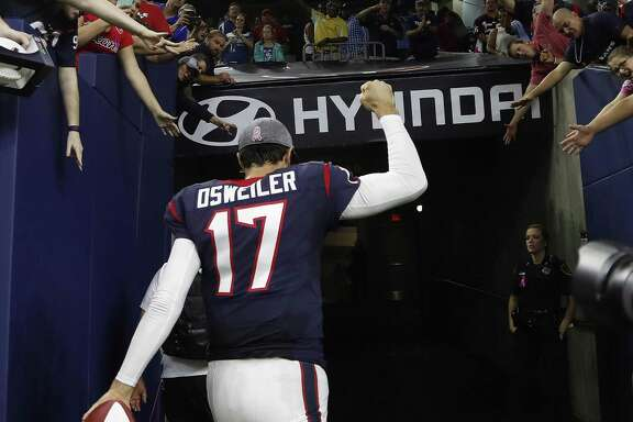 Texans quarterback Brock Osweiler celebrates the overtime win over the Indianapolis Colts with fans after at NRG Stadium on Oct. 16, 2016 in Houston.