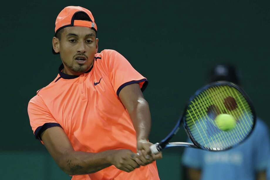 SHANGHAI, CHINA - OCTOBER 12:  Nick Kyrgios of Australia returns a shot against Mischa Zverev of Germany during the Men's singles second round match on day four of Shanghai Rolex Masters at Qi Zhong Tennis Centre on October 12, 2016 in Shanghai, China.  (Photo by Lintao Zhang/Getty Images) ORG XMIT: 671614219 Photo: Lintao Zhang / 2016 Getty Images