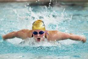 H.H. Dow High School freshman Mackayla Pirie competes in the 100 yard butterfly during a swim meet against Midland High Monday evening.