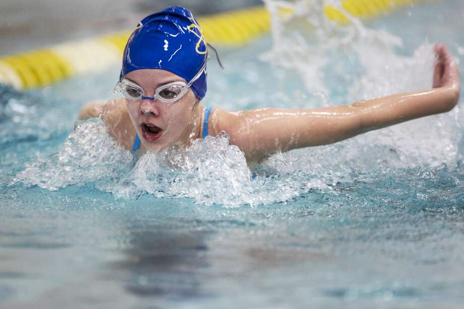 Midland High School freshman Jessica Perz competes in the 200 yard relay during a swim meet against H.H. Dow High School Monday. Photo: Theophil Syslo