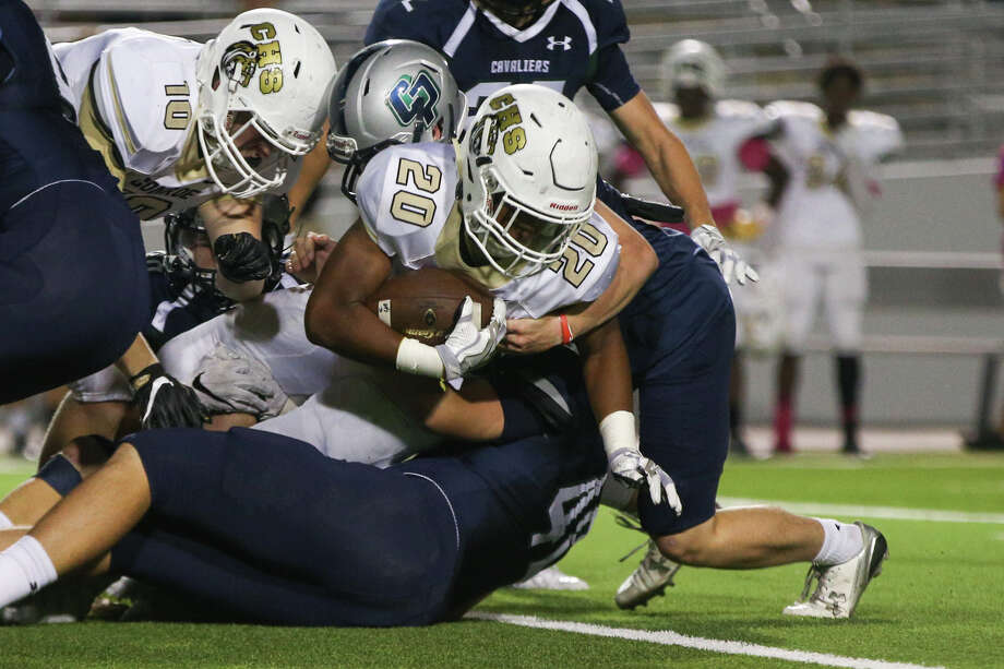 Conroe's Donaven Lloyd (20) leans forward for extra yardage as he's tackled by College Park defenders during the varsity football game on Friday. Photo: Staff Photo By Michael Minasi, Staff / © 2016 Houston Chronicle