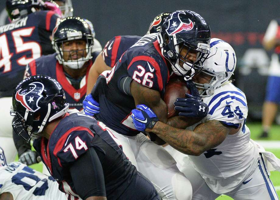 Houston Texans running back Lamar Miller (26) scores a touchdown on a 1-yard run against the Indianapolis Colts during the second half of an NFL football game Sunday, October, 16, 2016, in Houston. (AP Photo/George Bridges) Photo: George Bridges, FRE / FR171217 AP