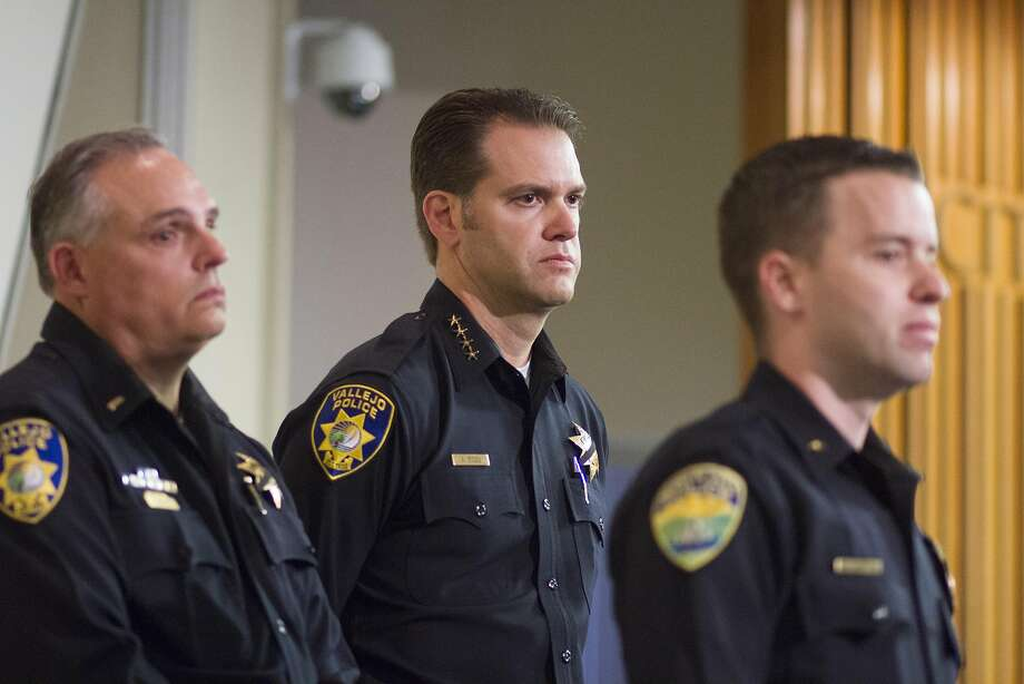 "Vallejo police Lt. Jeff Bassett, left, Chief Andrew Bidou, center, and Suisun Police commander Andrew White discuss the Sunday, Oct. 16 shooting shooting of Andrew Powell, 41, during a news conference at Vallejo City Hall on Monday, Oct. 17, 2016. ""Just like anyone else, officers are innocent until proven guilty,"" Lt. 